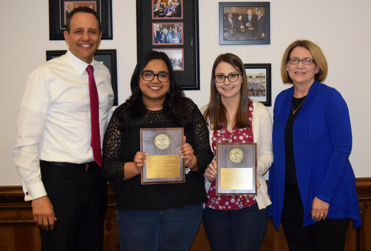 The OU Law Federal Bar Association Thurgood Marshall Memorial Moot Court Competition team of Bakhtawar (Becky) Hafiz and Taylor Freeman Peshehonoff with OU College of Law Dean Joseph Harroz Jr. and OU Law Director of Competitions Professor Connie Smothermon