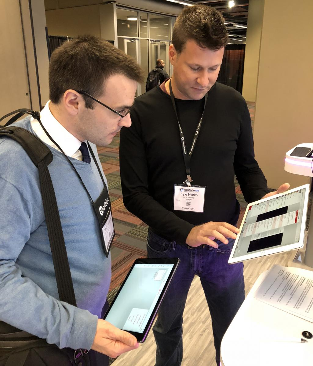 OU Law Student Zach Williams watches a demonstration of TrialPad, a trial presentation app, at ABA TECHSHOW.