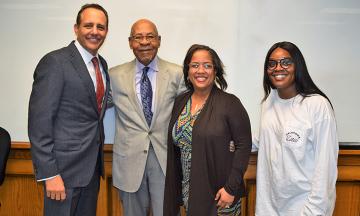 Dr. George Henderson (center) with Dean Joseph Harroz, Director of Career Development Alicia Currin-Moore and BLSA President Micah Mahdi.