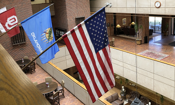 American flag hanging in the Boren Atrium at the OU College of Law.