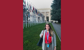 Liz Stevens in front of the UN headquarters in Geneva